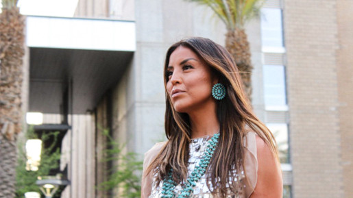 a woman wearing indigenous jewellery