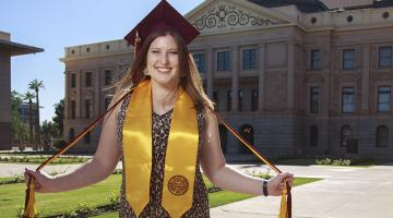 Aly Perkins spring 2019 ASU graduate in front of the Arizona state capitol building