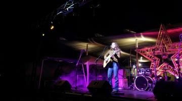 ASU engineering student Brittany Tews onstage with a guitar