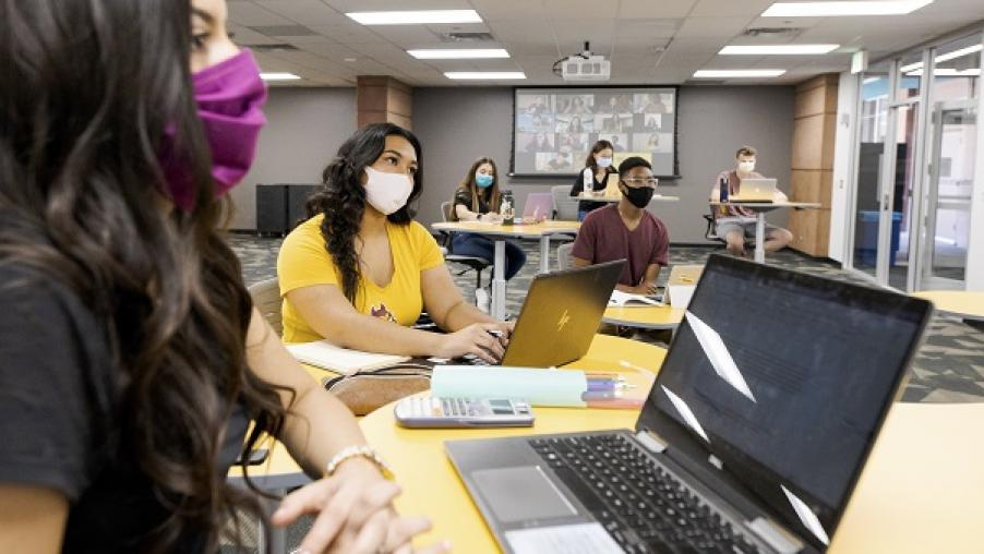 Students in masks in a classroom for an ASU Sync class