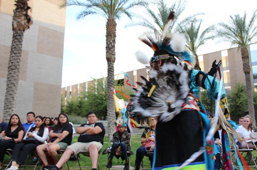 ASU student in traditional native costume dances at Hassayampa