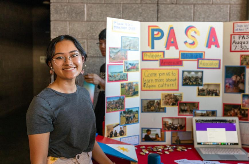 A student in ASU's PASA club tables at CultureFest