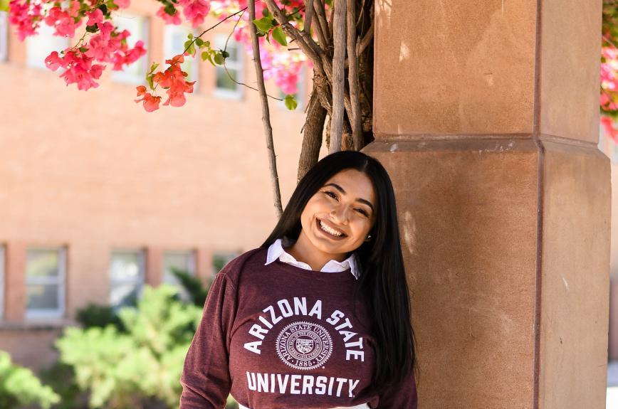 ASU grad Cassandra Ortiz in front of Hayden Library on ASU's Tempe campus