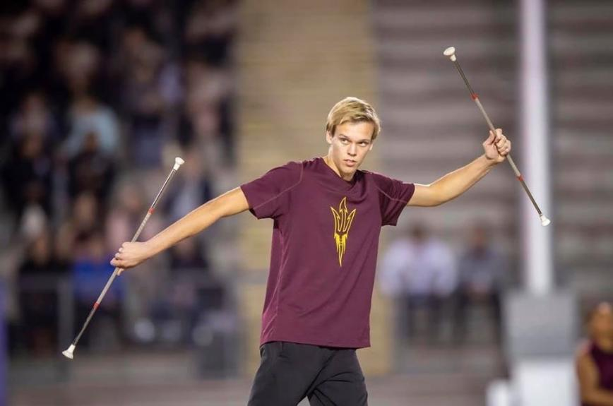 Cody Carton baton twirling at an ASU Football Game.