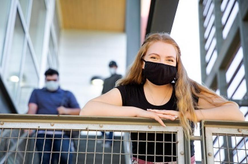 Students in masks on a stairway at ASU