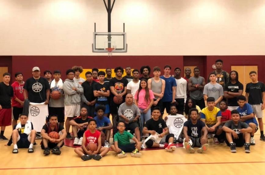 David Solano and his after-school program for Phoenix youth pose for a picture