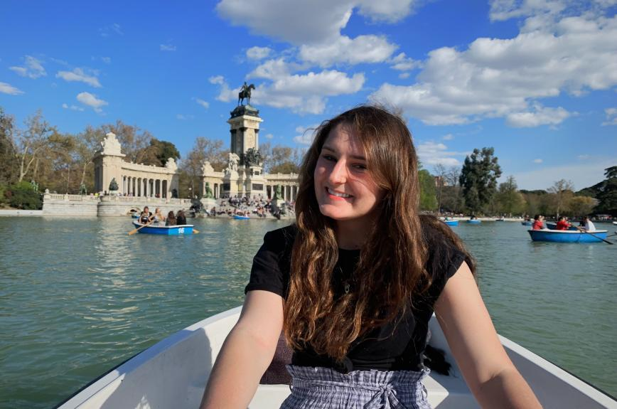 Student Julianna Drambarean sits in row boat and poses.