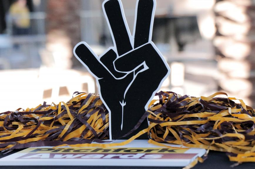 Pitchfork Award with maroon and gold pom pom