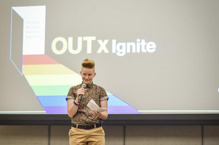 A student onstage at ASU's OUTxIgnite storytelling event for Fall Pride Week 2019