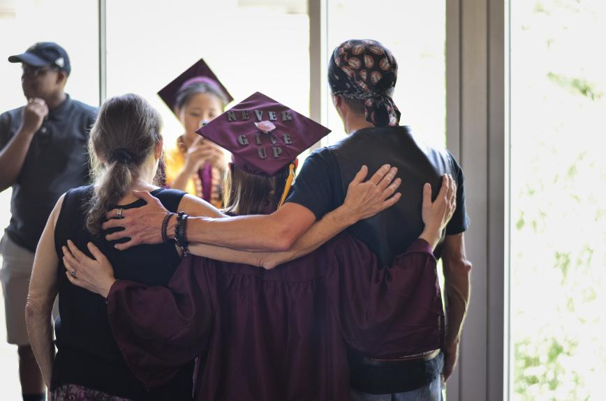 A graduate poses at the ASU Resiliency graduation spring 2019