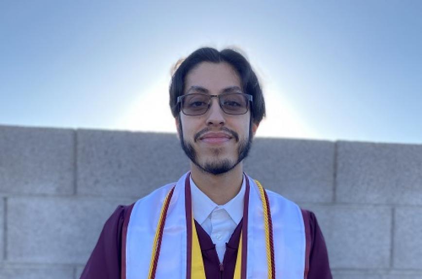 Rogelio Garcia in his ASU graduation gown and TRIO stole