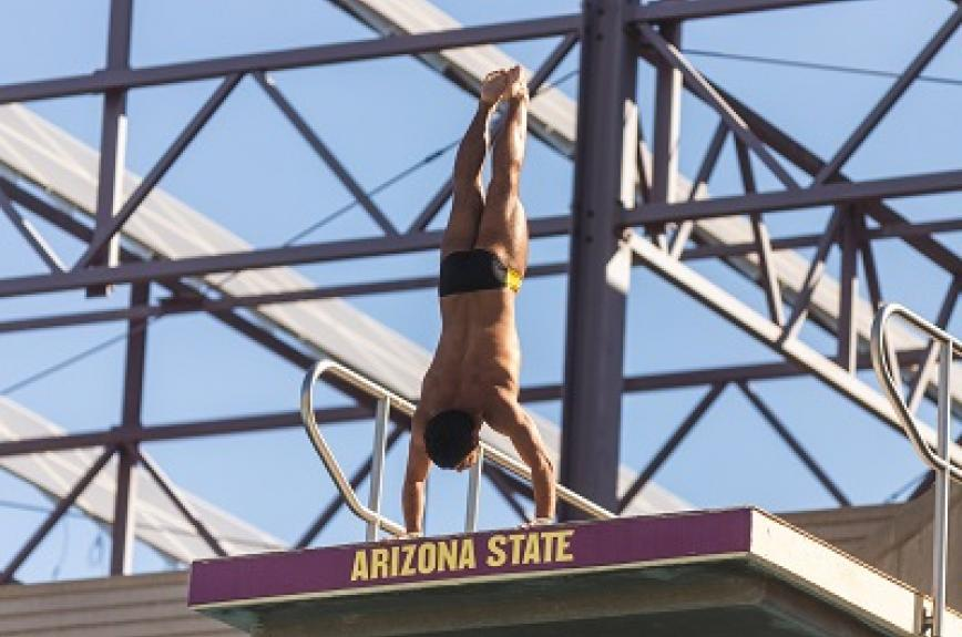 ASU diver Youssef Selim beginning a dive in a handstand