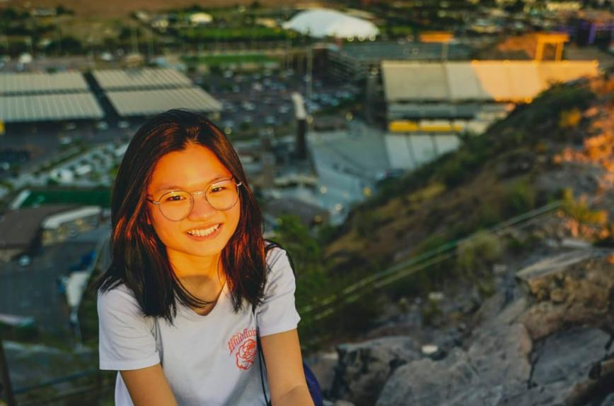 Yvonne Chook, a third-year student studying biomedical engineering, smiles on top of A Mountain.