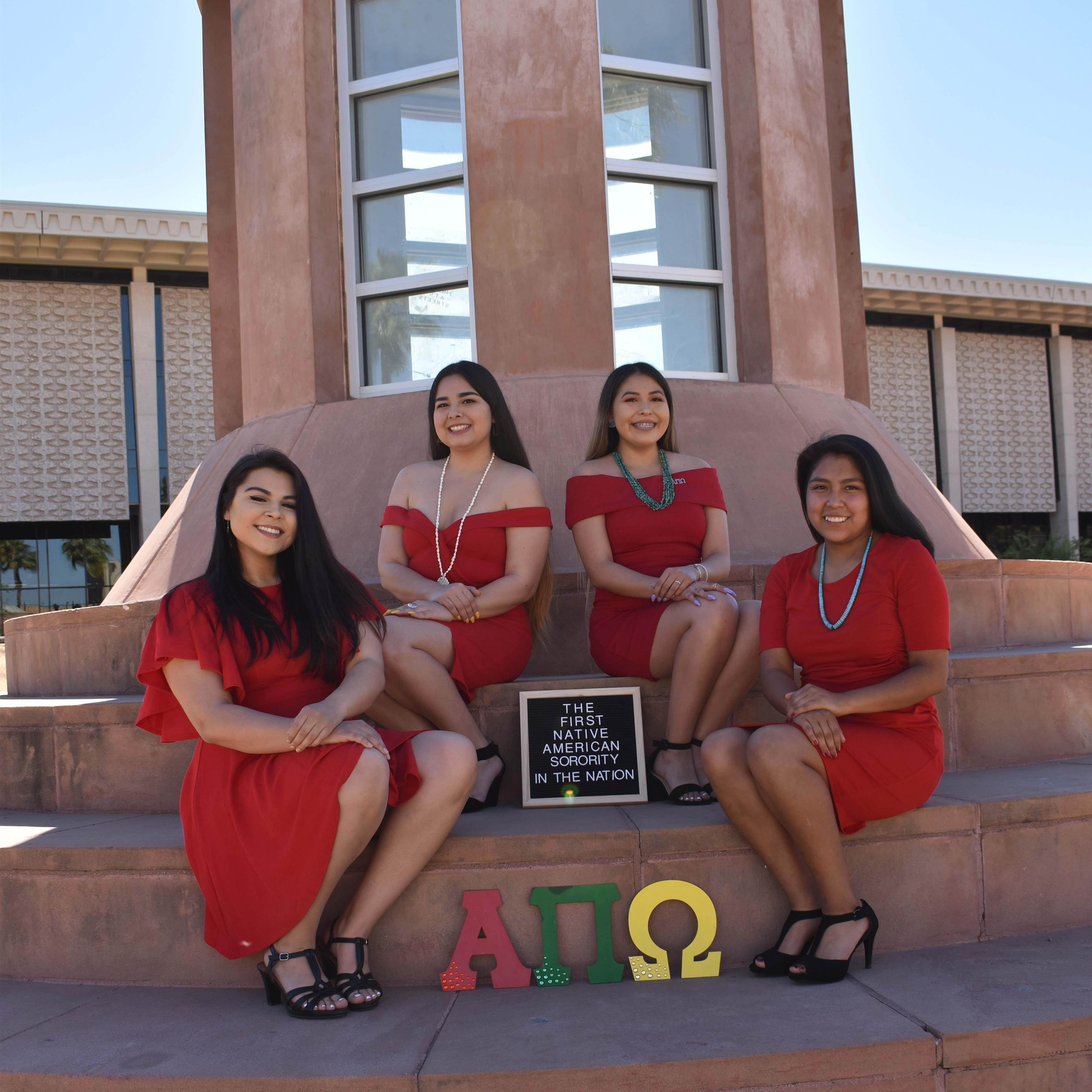 Native ASU sorority sisters pose at Hayden Library at ASU's Tempe campus