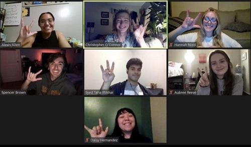 ASU students using ASL signs for forks up and I love you in a Zoom grid