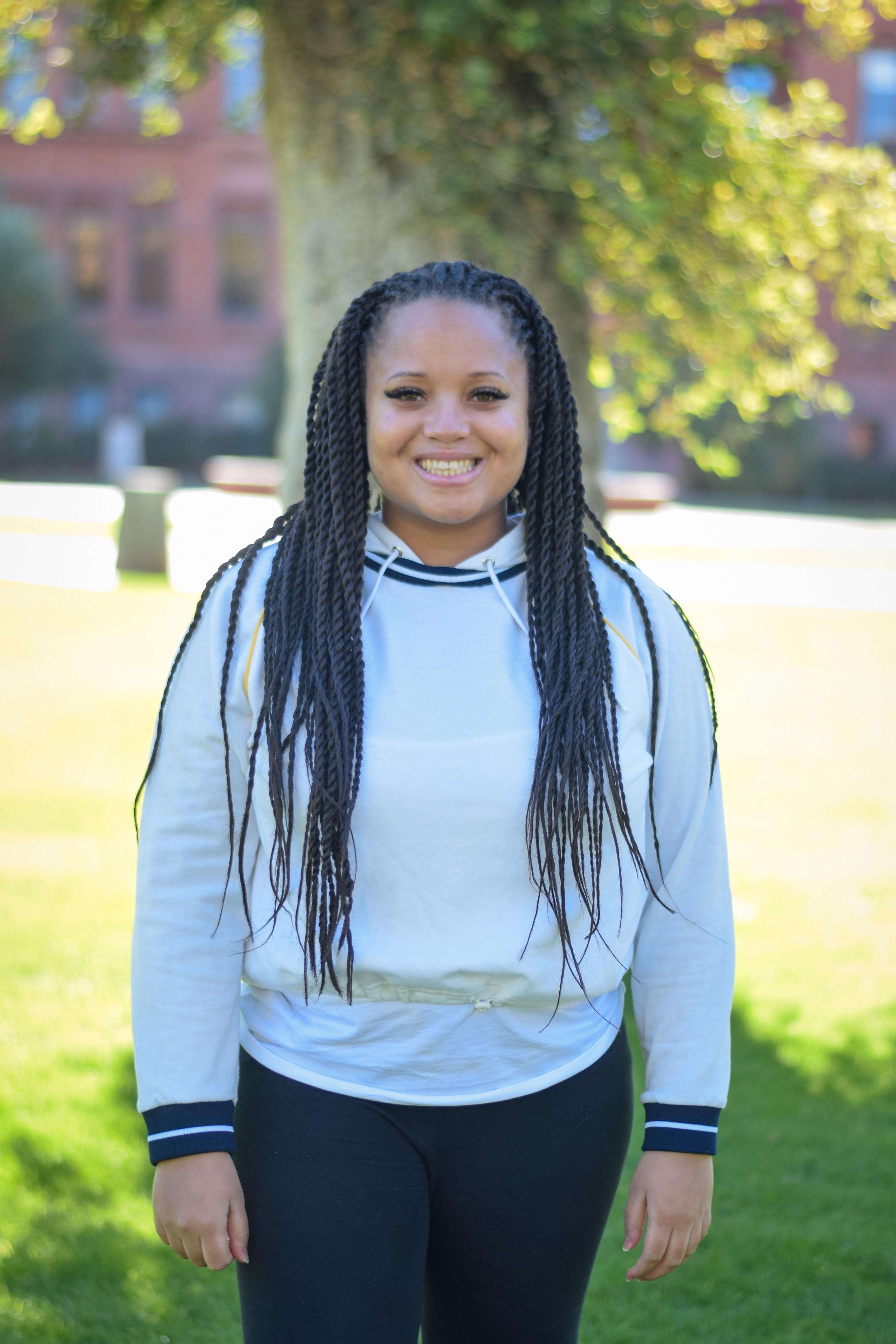 Graduate Ashley Turner stands strong in front of Old Main at Arizona State University.