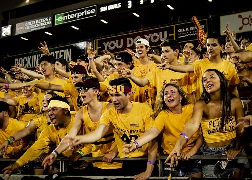 ASU Inferno student section students throw pitchforks at a football game