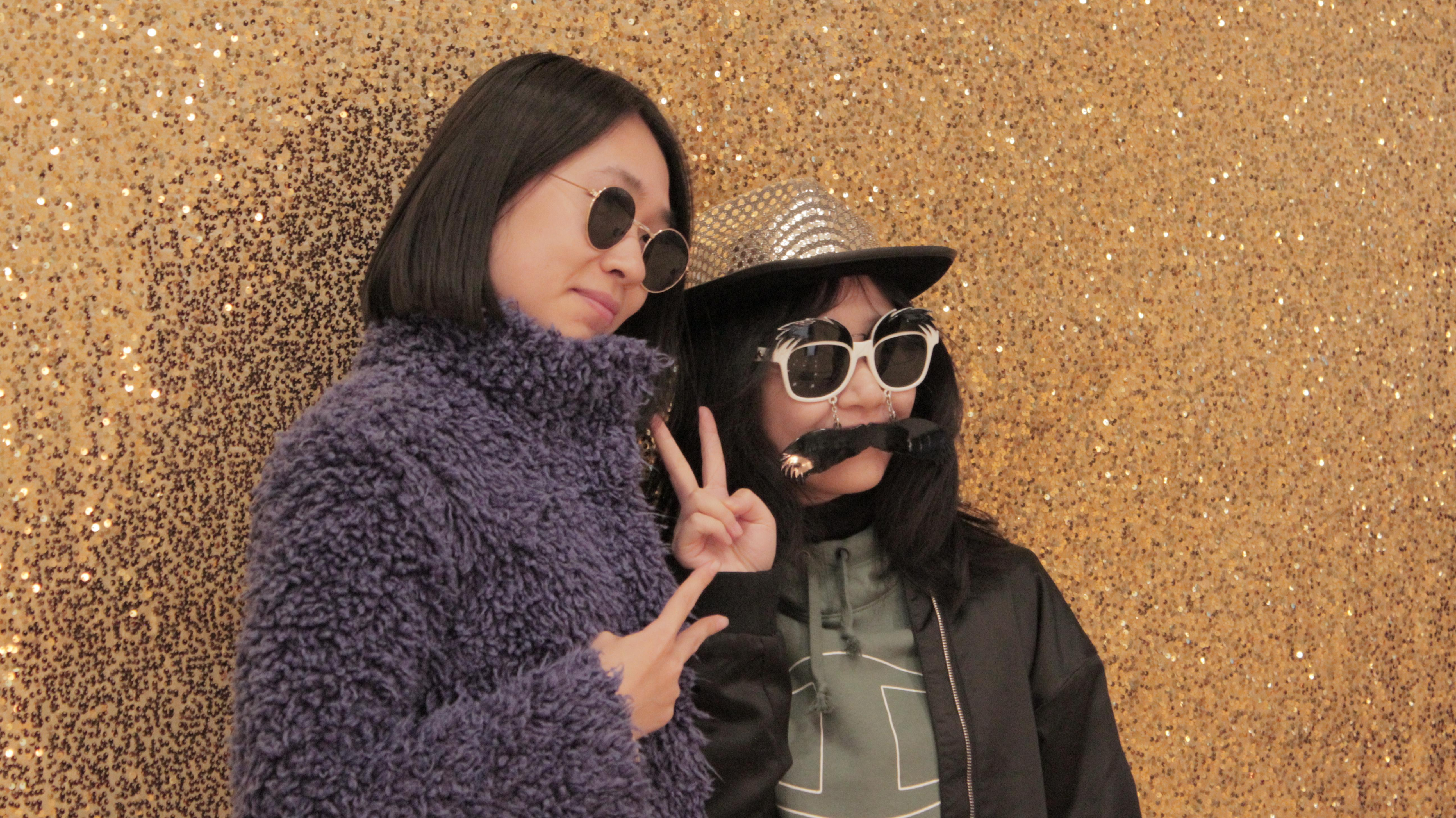 ASU international students pose in a photobooth for the 2019 orientation carnival
