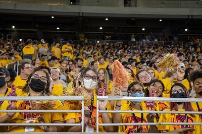 Students cheering wearing gold at