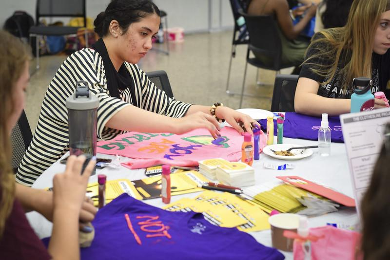 Women make T-shirts at Women's Welcome
