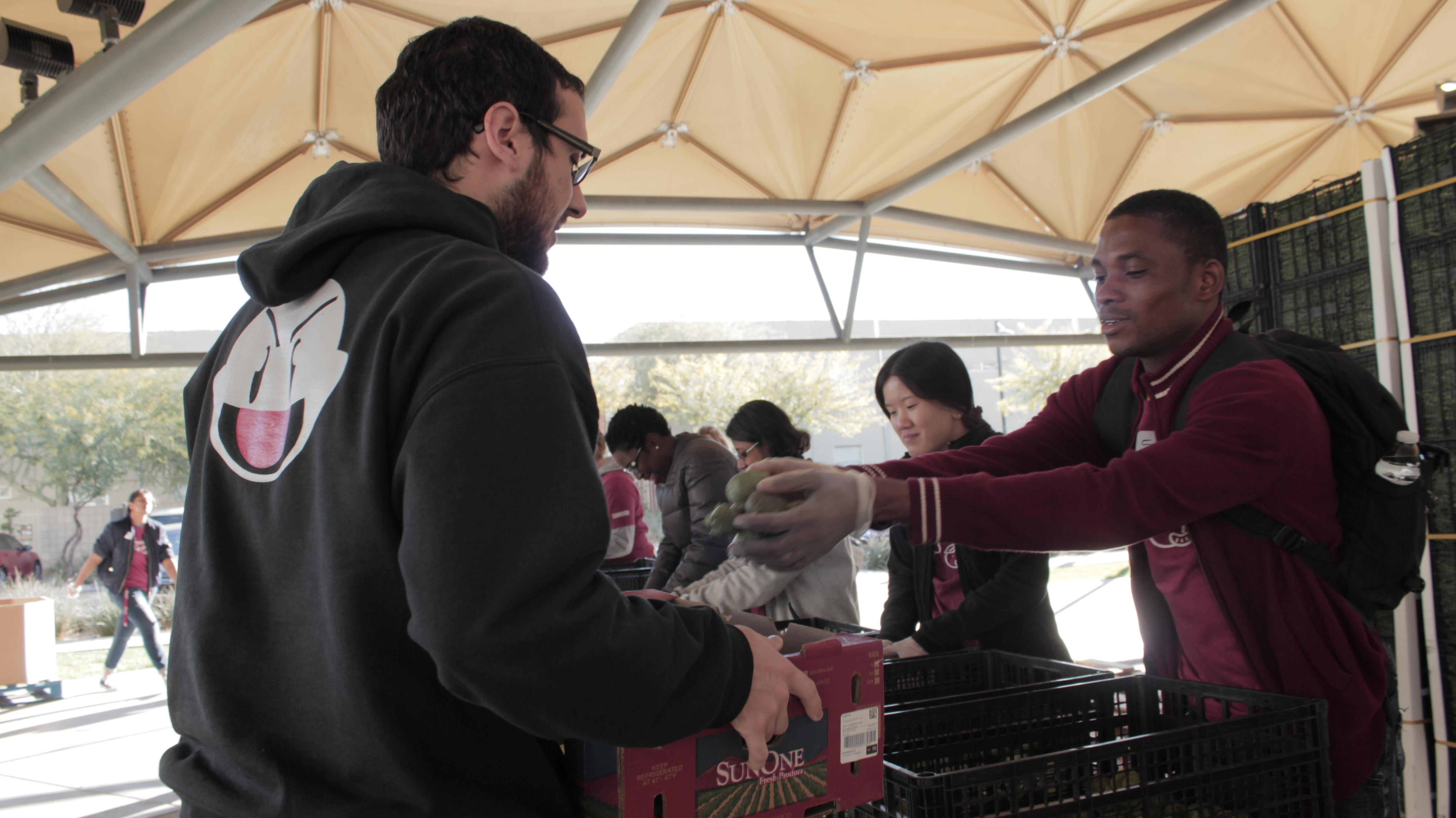ASU students at the Vista del Sol golden dome hand out food with Borderlands Produce Rescue