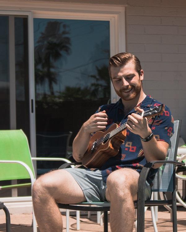 Colton Lish playing a ukelele