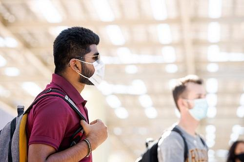Students in masks in front of the Memorial Union at ASU's Tempe campus