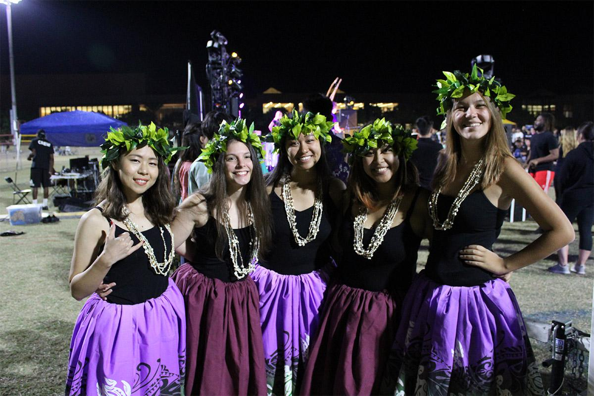 Performers in a pacific island group pose for a photo at International Night