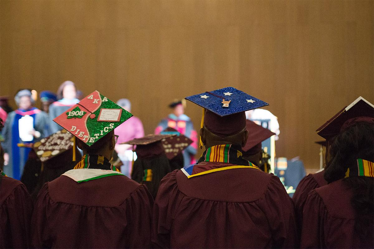 Fall 2017 Black African Convocation participants personalize their caps.