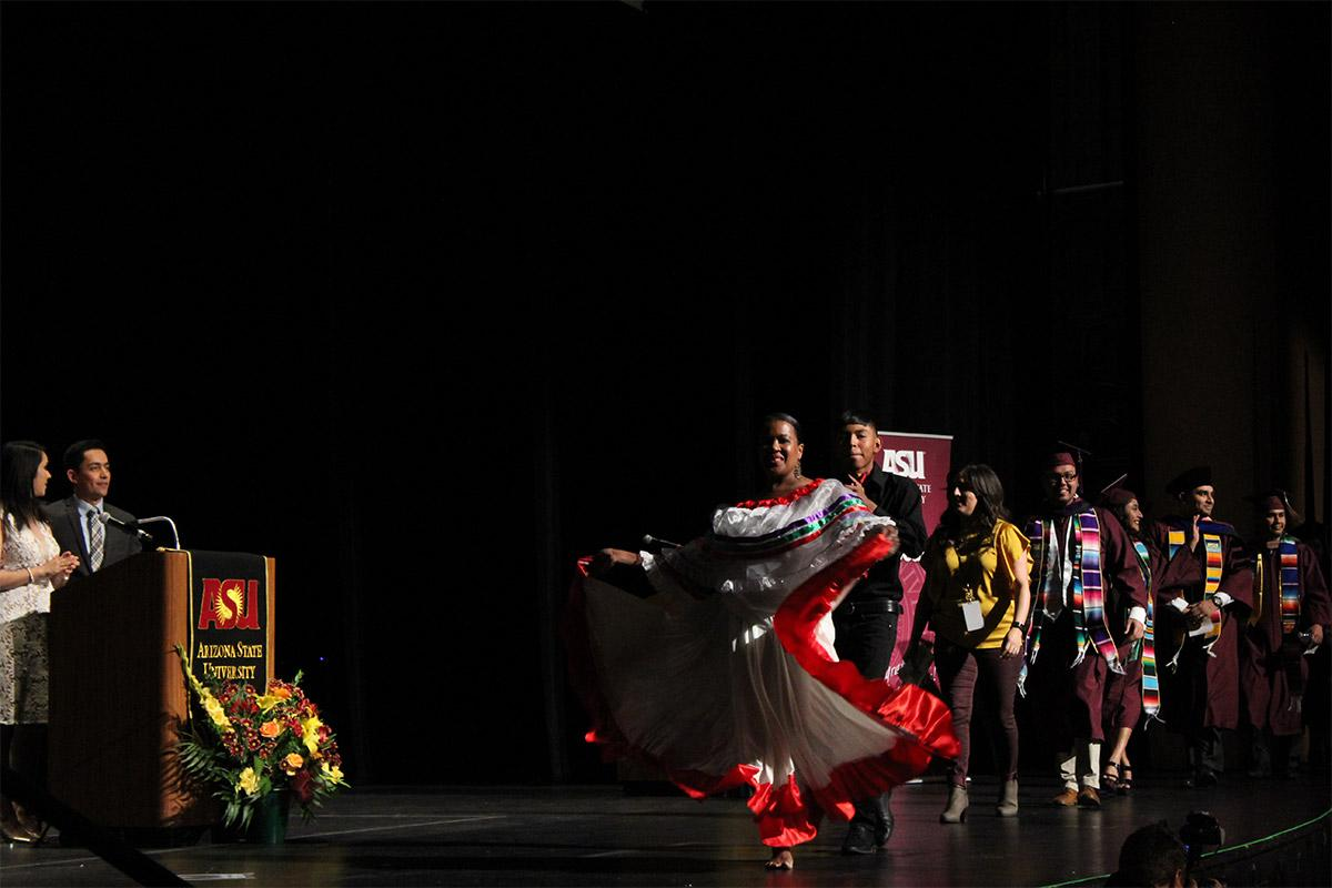 Dancers cross the stage in celebration of the Fall 2017 Hispanic Convocation graduates.