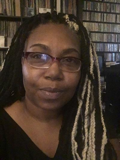 Priscilla Searcy in front of bookshelves