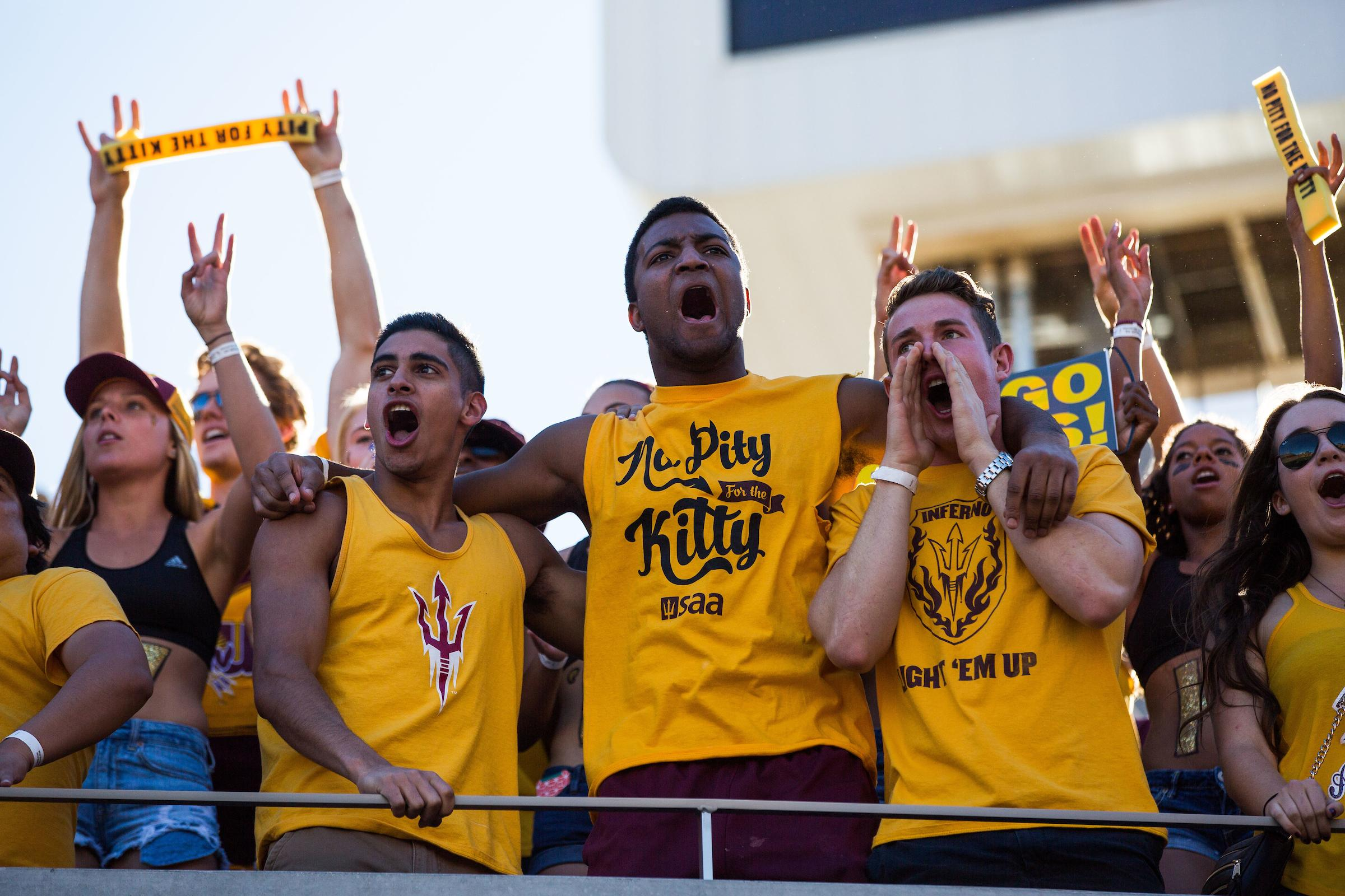 Students in yellow No Pity for the Kitty shirts at the 2015 Territorial Cup