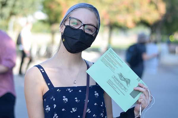 ASU student in a mask with her ballot ASU Tempe Election Day 2020