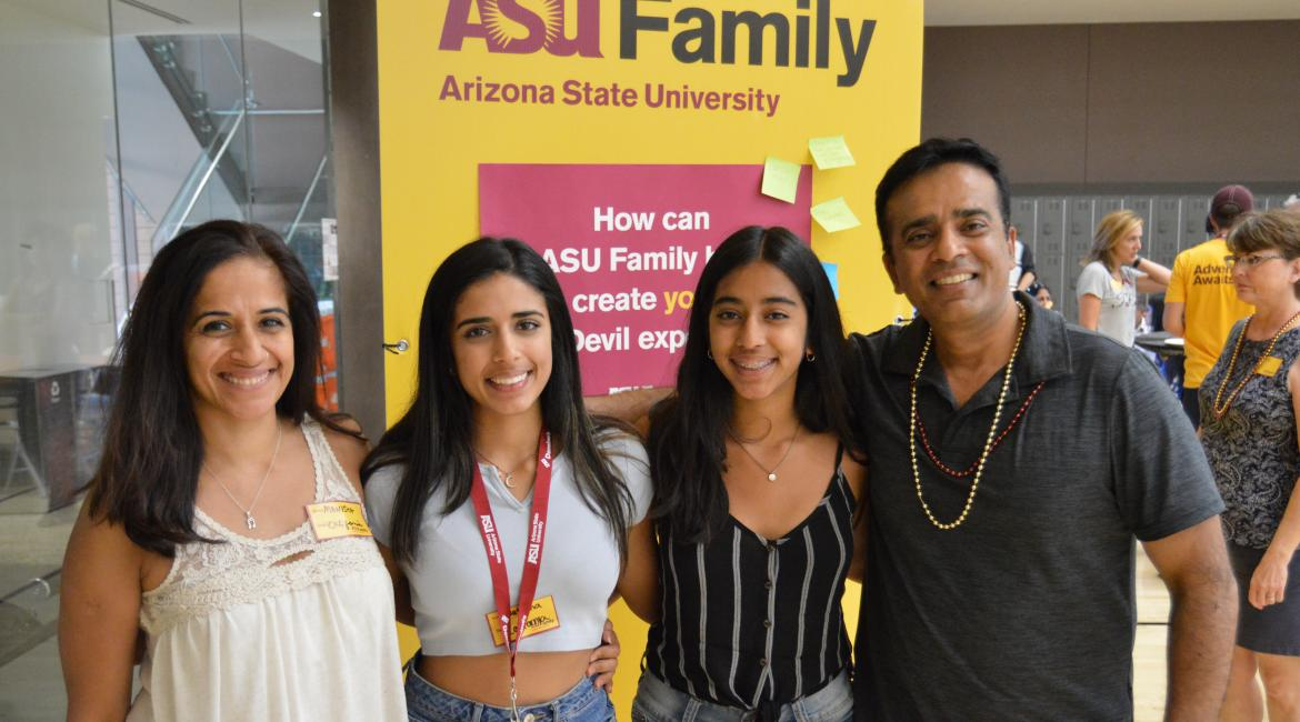 Four family members pose at an ASU Family welcome event