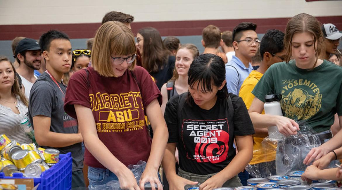 ASU students sort cans at a community service event for Changemaker Central at Arizona State University in Tempe