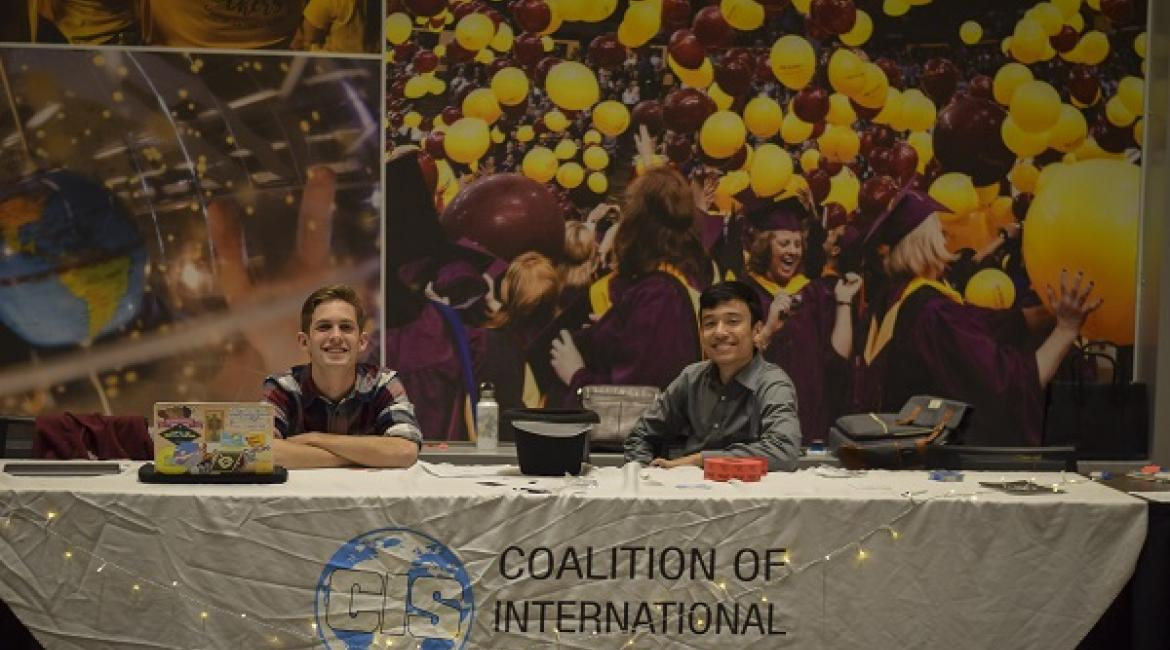 Coalition of International Students students at a table at ASU's Student Pavilion